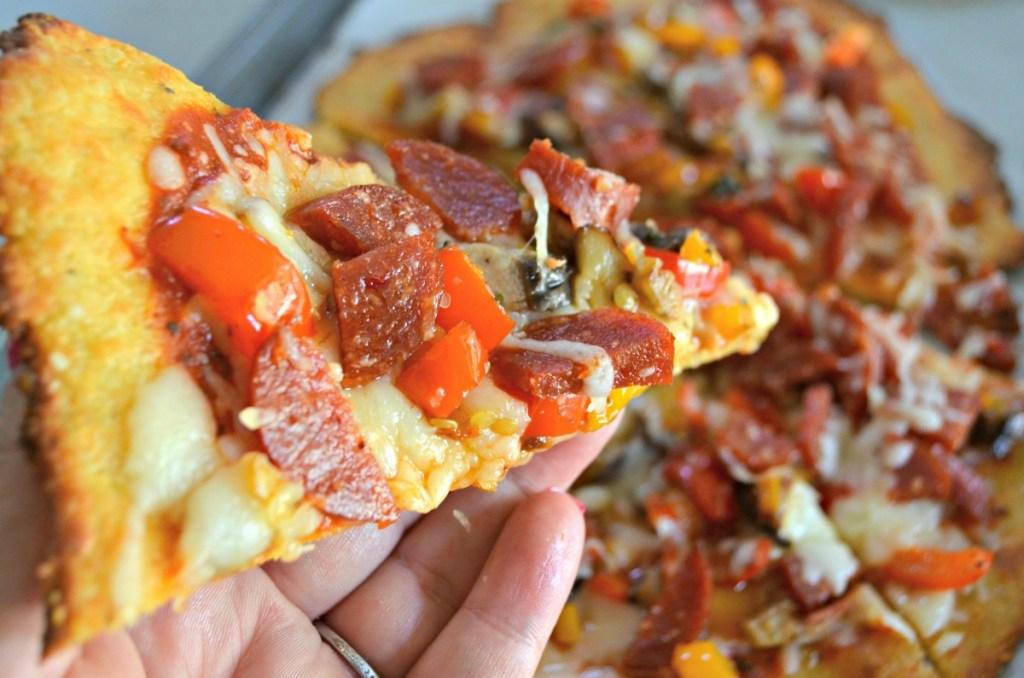 holding fat head pizza