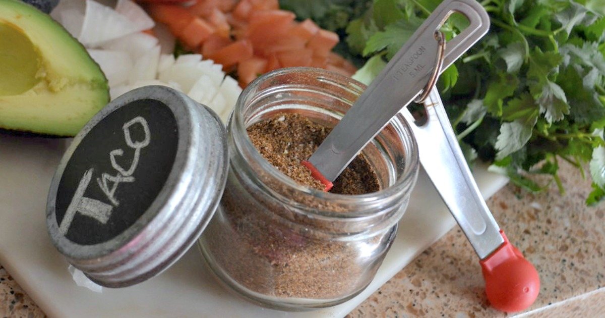 homemade taco seasoning in a jar with a measuring spoon