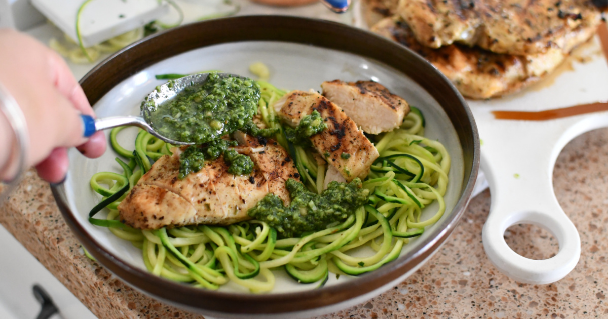 plating chicken pesto with zoodles
