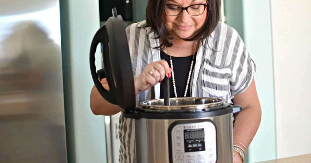 woman cooking with instant pot