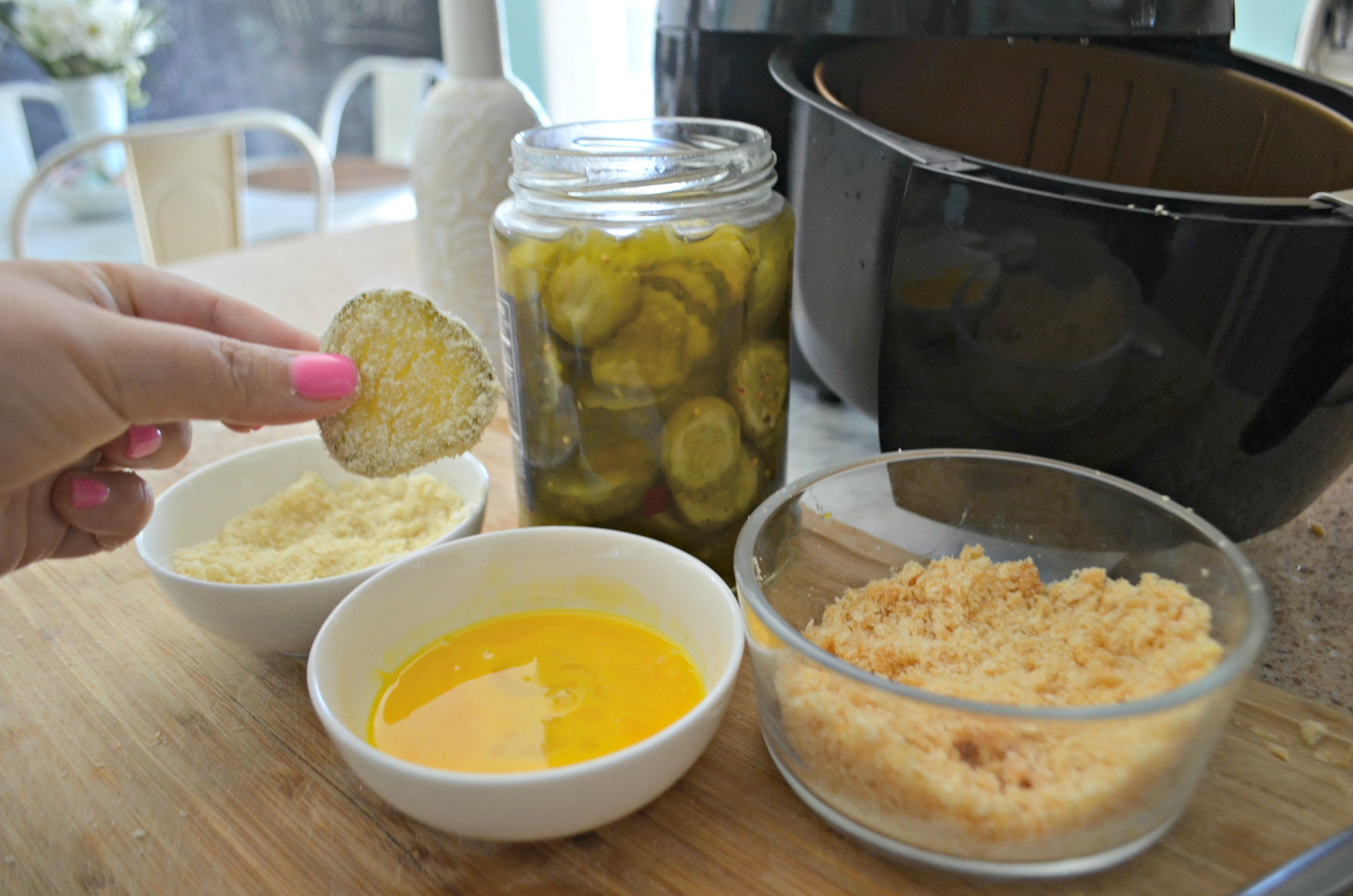 Dredge pickle slices and air fry for an easy appetizer everyone will love.