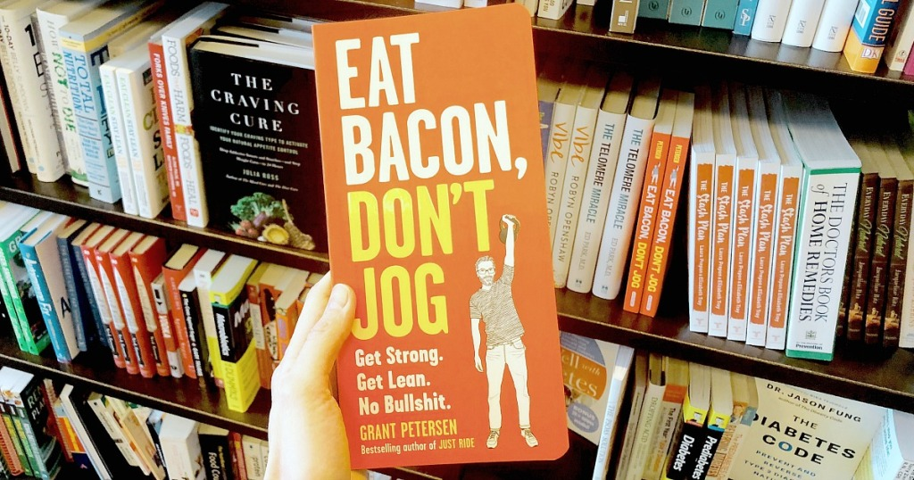 holding Eat Bacon, Don't Jog book at bookstore