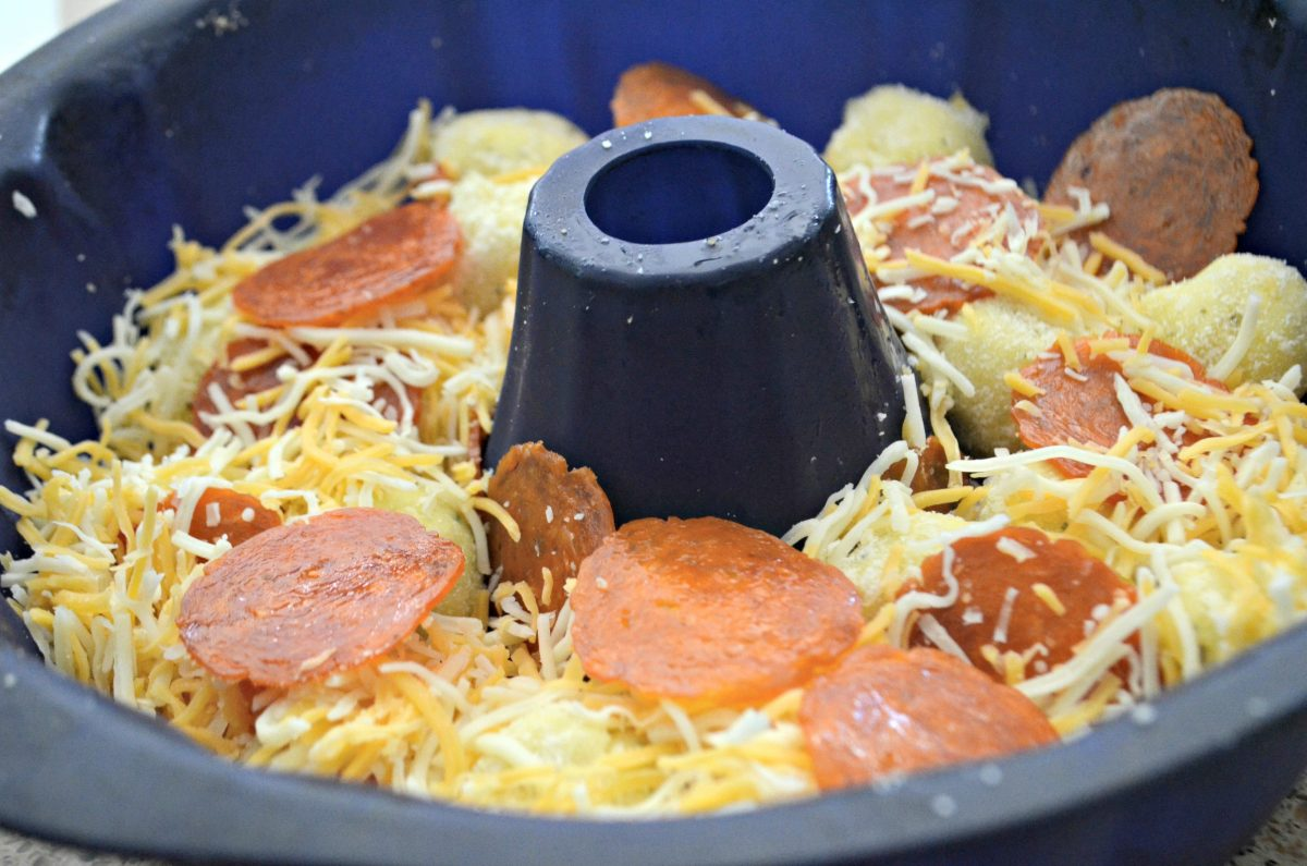 pull apart keto pizza rolls in the pan prior to baking
