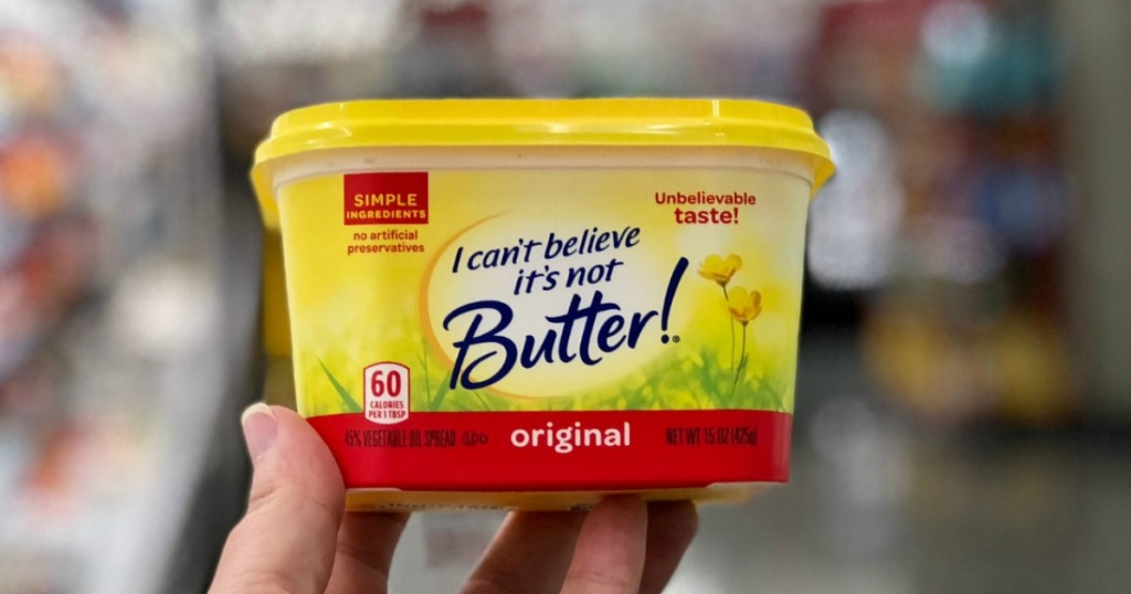 holding container of I Can't Believe It's Not Butter