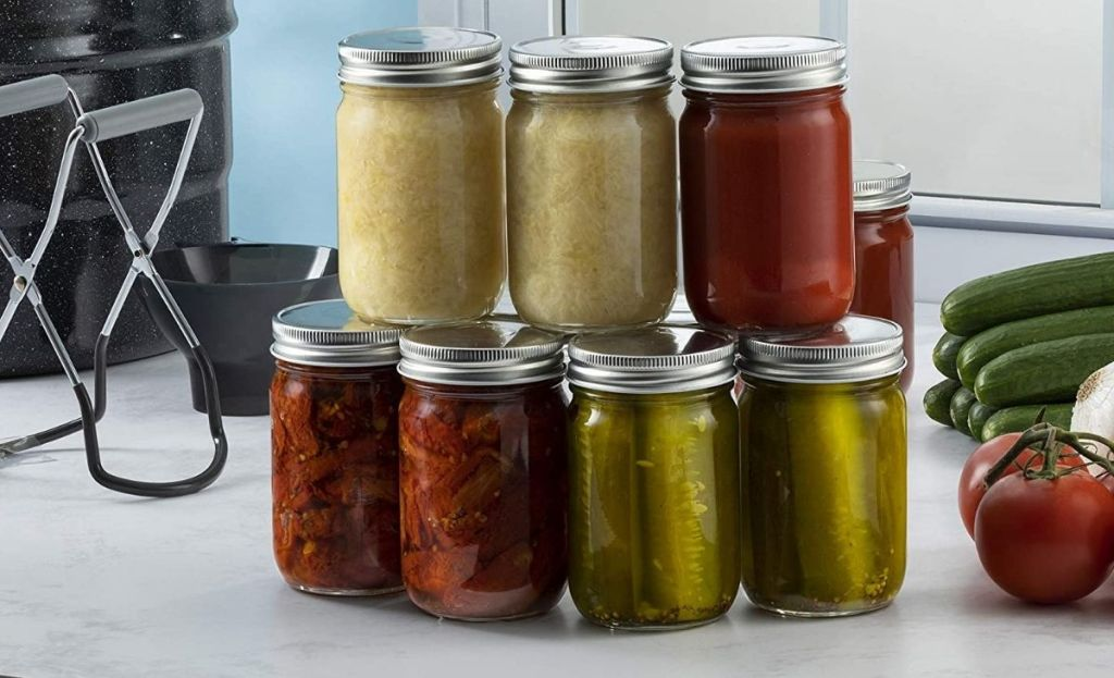 Mason jars filled with pickles and sauces on a counter