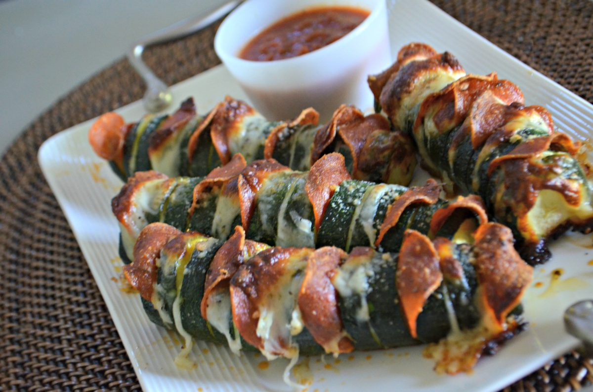 easy pizza stuffed hasselback zucchini - after baking and on a plate