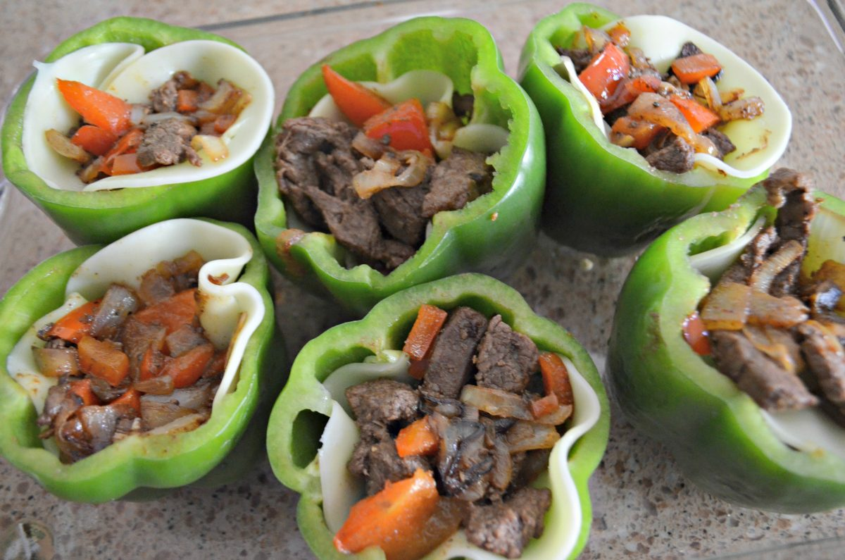 Stuff the green peppers with the meat, cheese, and vegetables