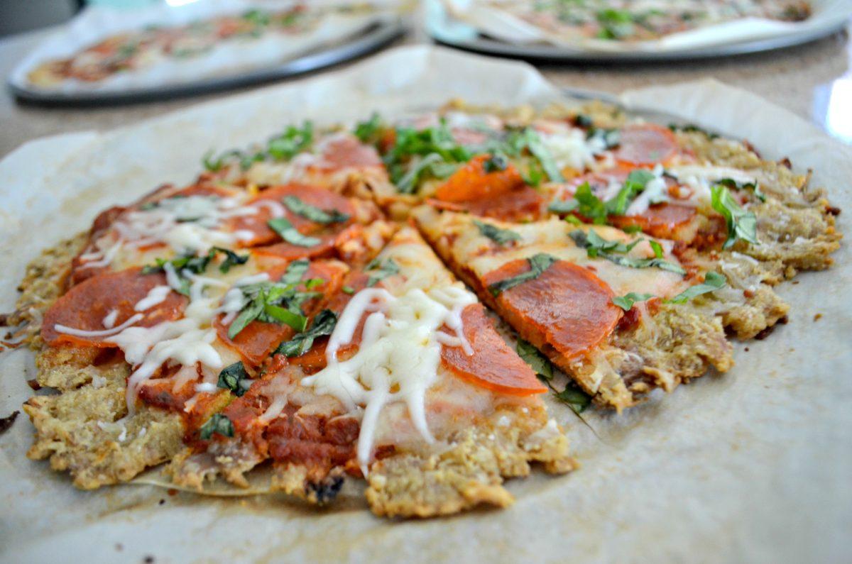 chicken crust pizza, sliced