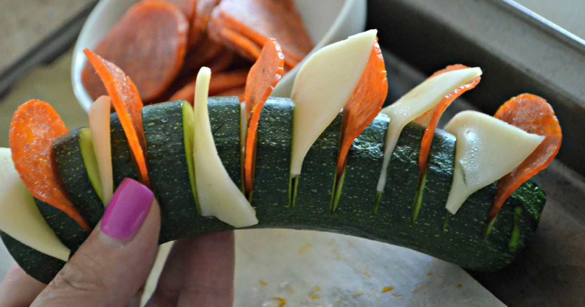 easy pizza stuffed hasselback zucchini - before baking