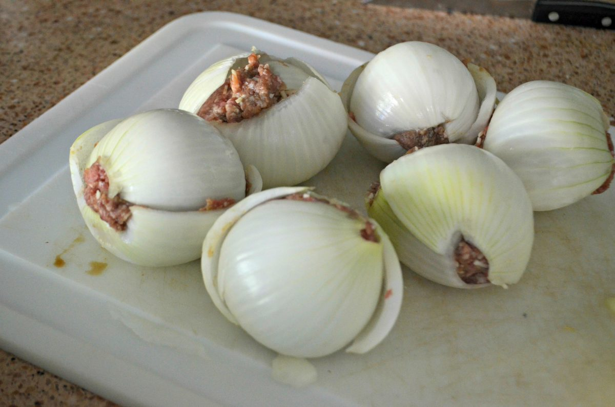 These keto onion cheeseburger bombs are perfect for grilling and camping – onion and hamburger assembled and on a tray