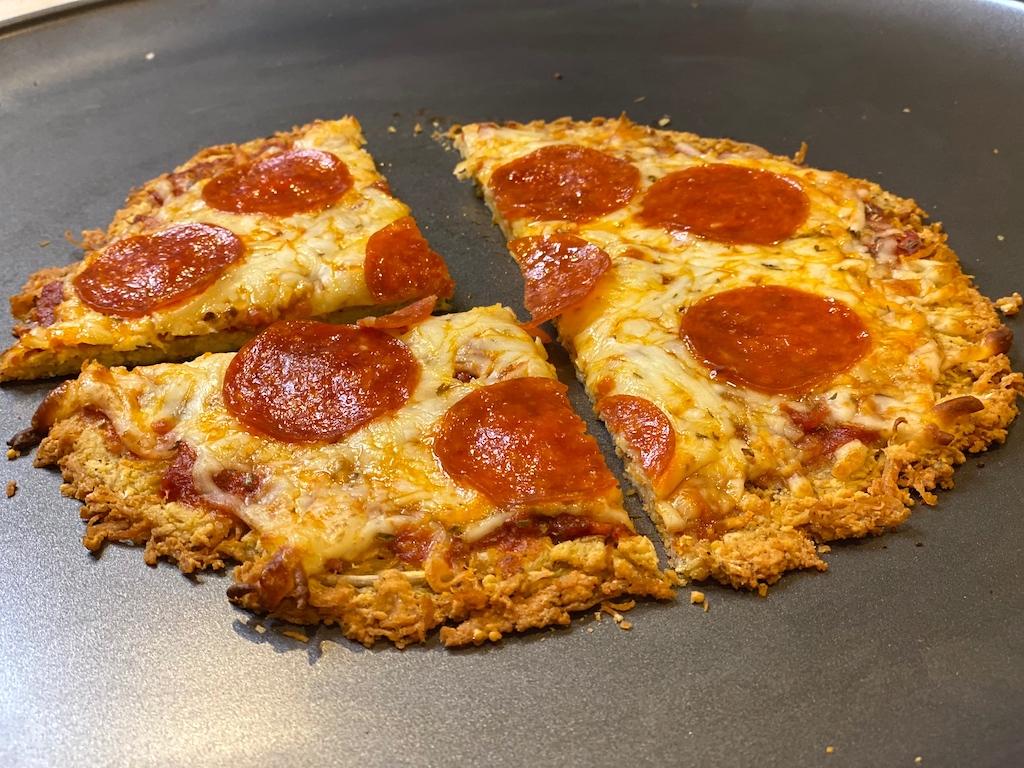 slicing pepperoni pizza chicken pizza crust