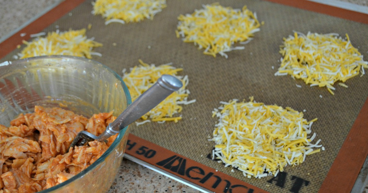 a bowl of chicken and cheese rounds on a silpat baking mat