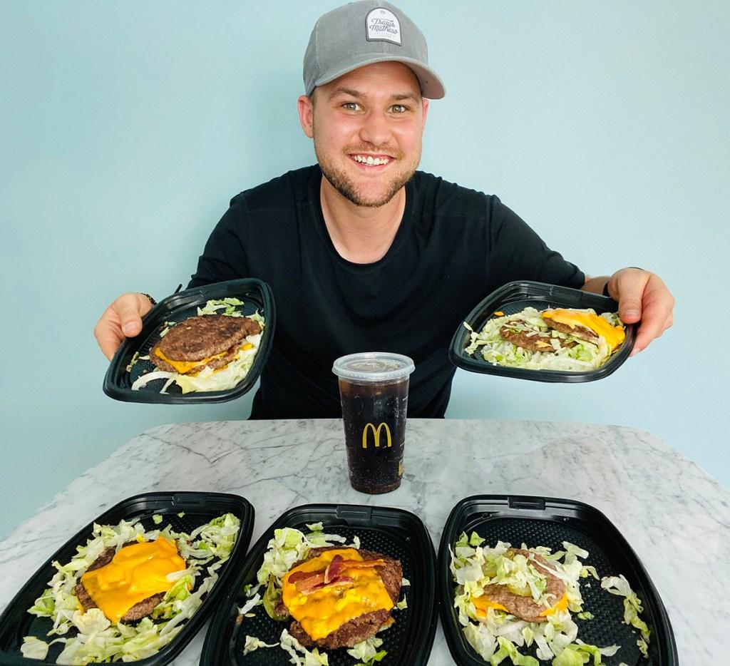 man with mcdonalds cheeseburgers
