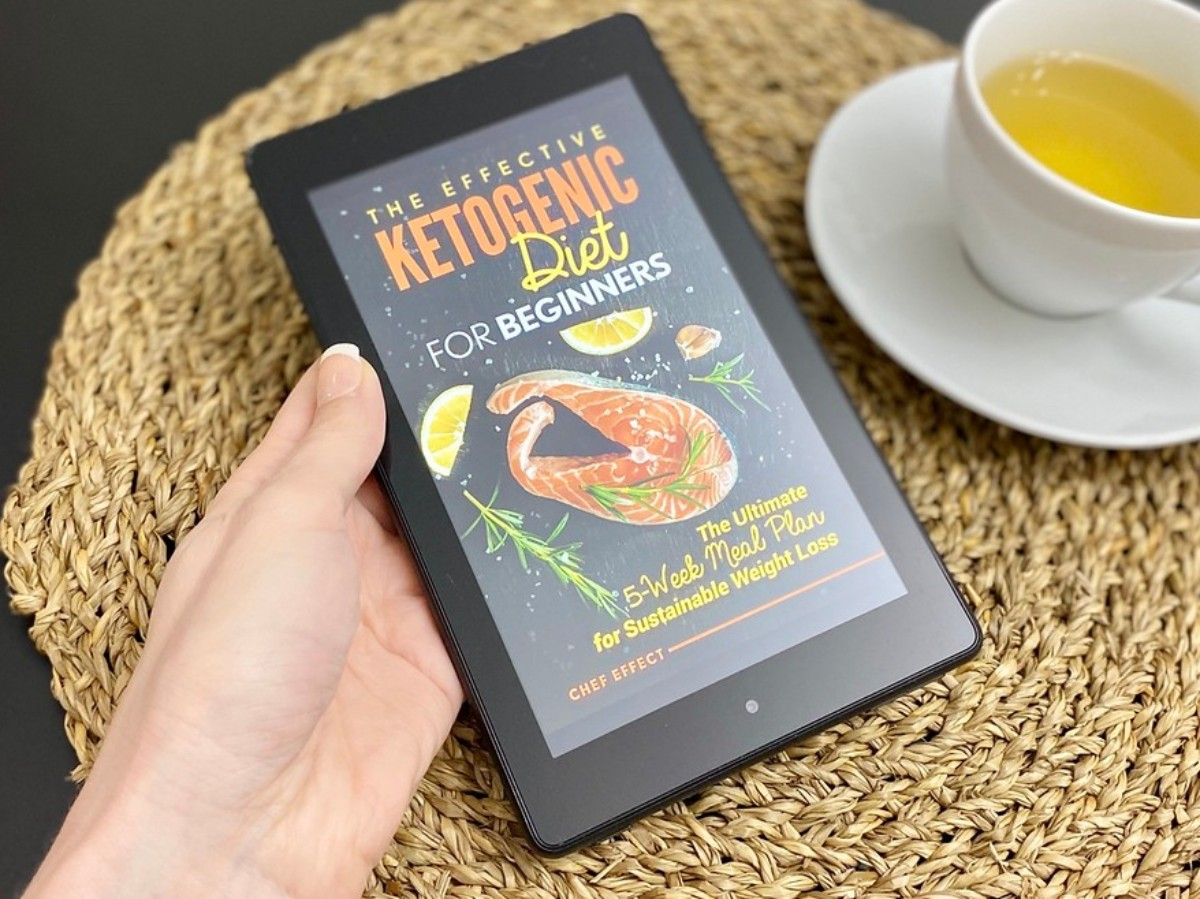 hand holding Kindle showing cover of Keto Diet Book