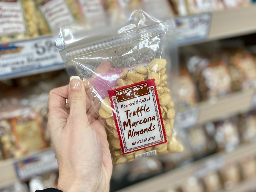hand holding bag of Marcona Almonds from Trader Joe's