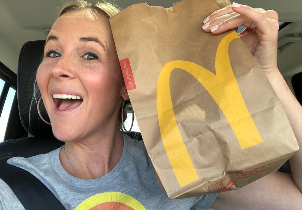 woman holding mcdonalds bag