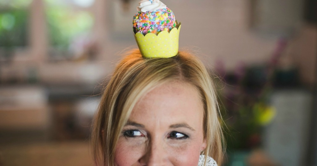 woman with cupcake on her head