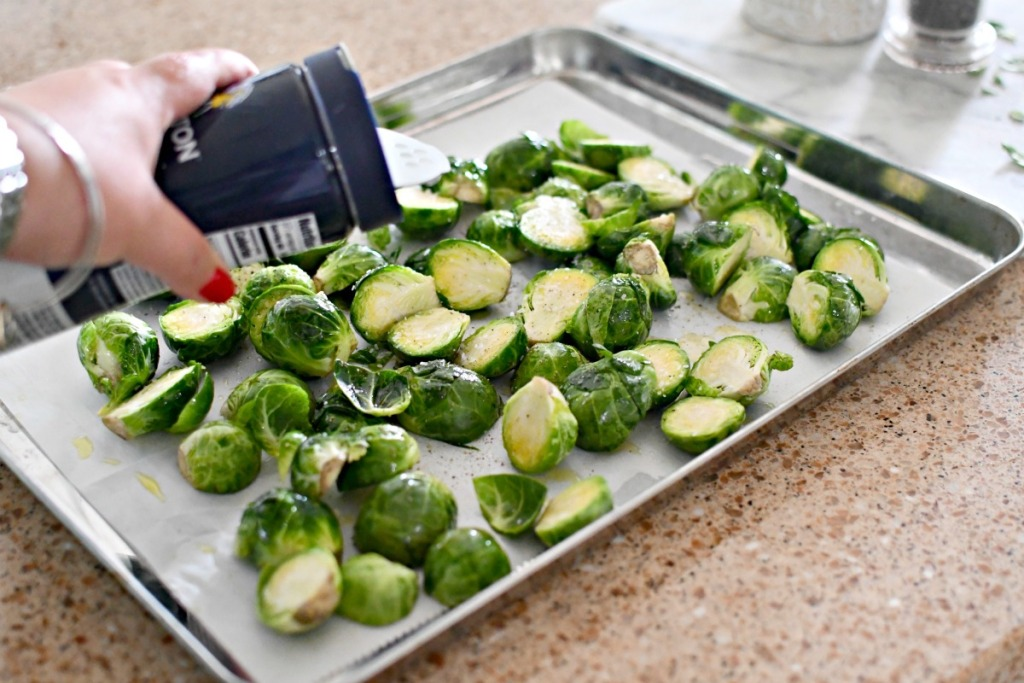 putting salt on brussels sprouts