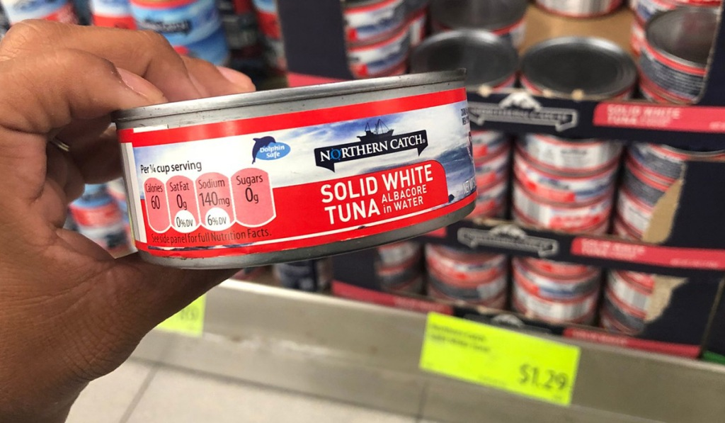hand holding a can of tuna