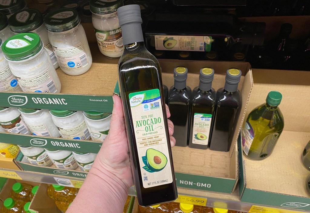 hand holding bottle of avocado oil at aldi