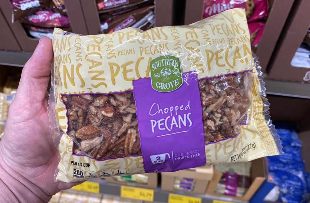 hand holding bag of pecans