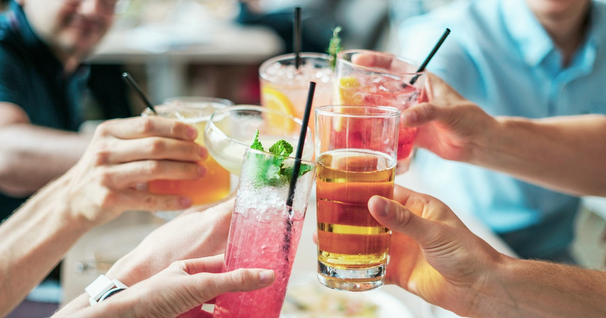 keto diet alcohol intolerance tips happy hour – group of people with drinks cheersing