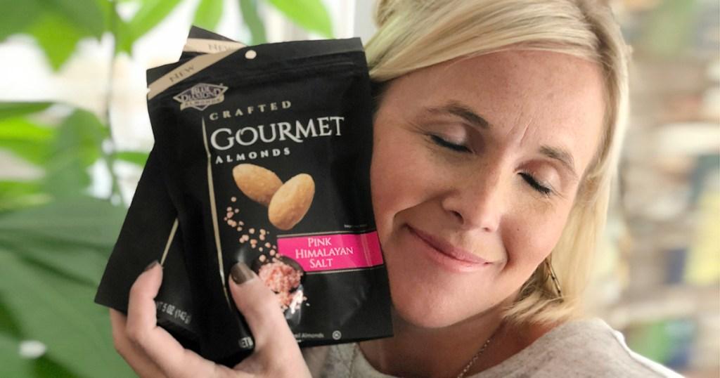 woman holding Blue Diamond gourmet almonds
