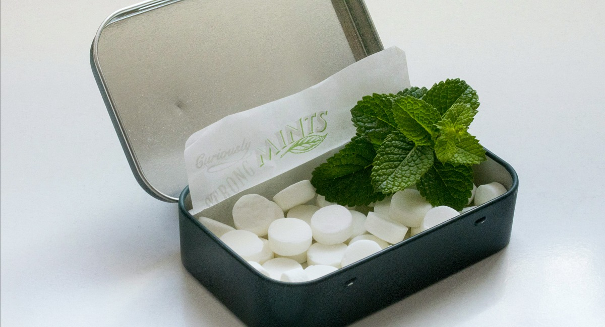 peppermints with mint leaf in tin