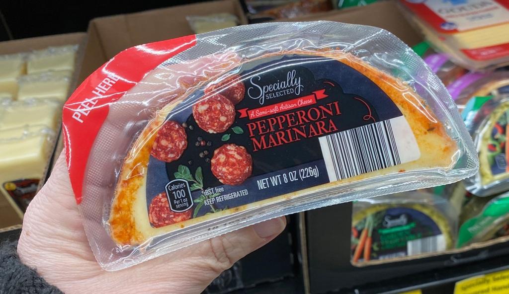 hand holding pepperoni marinara cheese best keto finds aldi