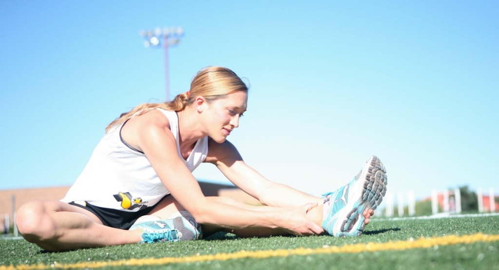 athletic woman stretching muscles
