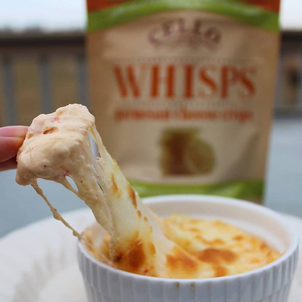 dipping whisps cheese crisp into dip