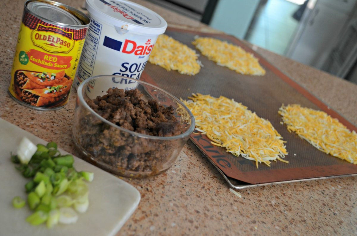 Putting ingredients together for the ground beef keto enchiladas