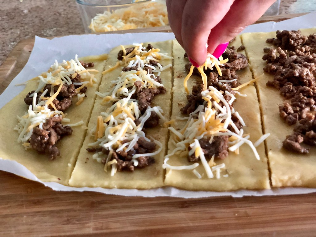 Easy Keto Taco Breadsticks – adding the stuffing toppings