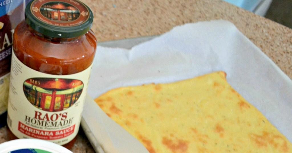 RAO'S Marinara next to pizza crust