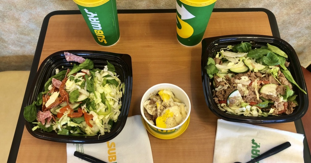 Subway top shot of two sandwiches made into salads
