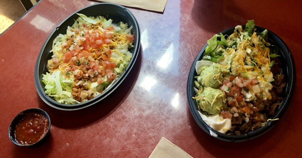 two Taco Bell salads on table