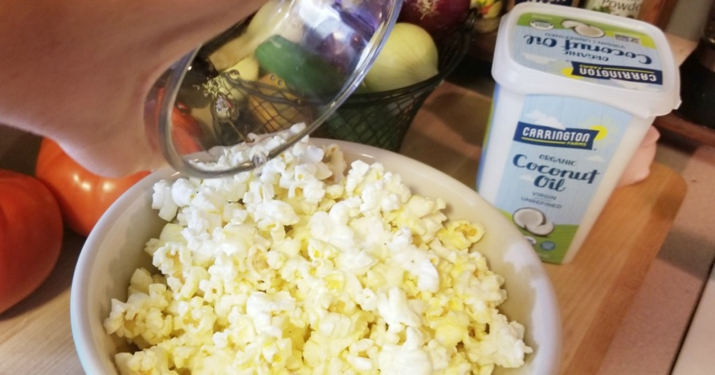 melted carrington coconut oil poured over popcorn