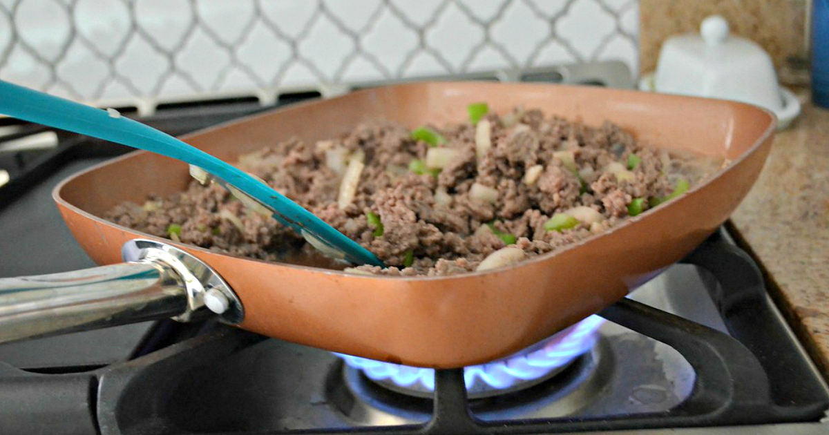 copper chef cookware are the best nonstick pans I own. Shown here on the stove cooking meat