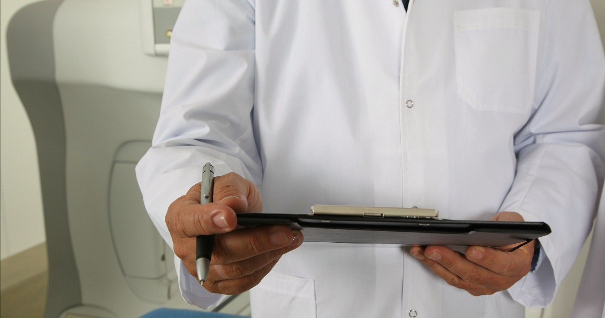 doctor holding patient chart