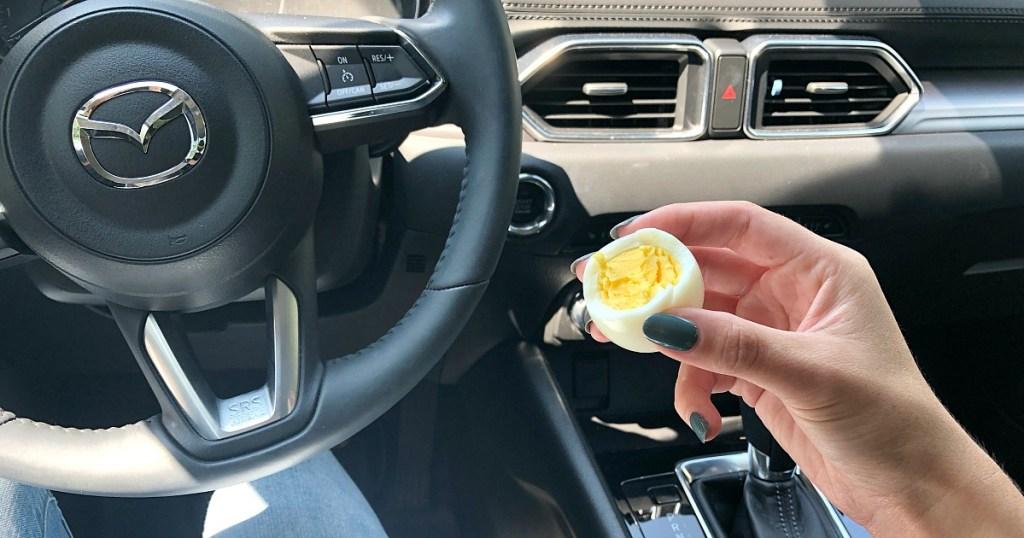 eating hard boiled egg in car for on the go snack