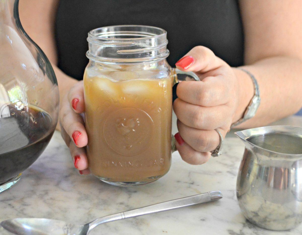 delicious keto cold brew coffee – Lina holding a mug of coffee