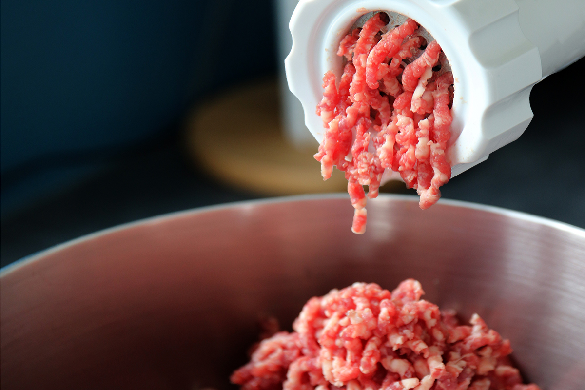 best keto shopping tips for finding meat – ground beef coming out of meat grinder