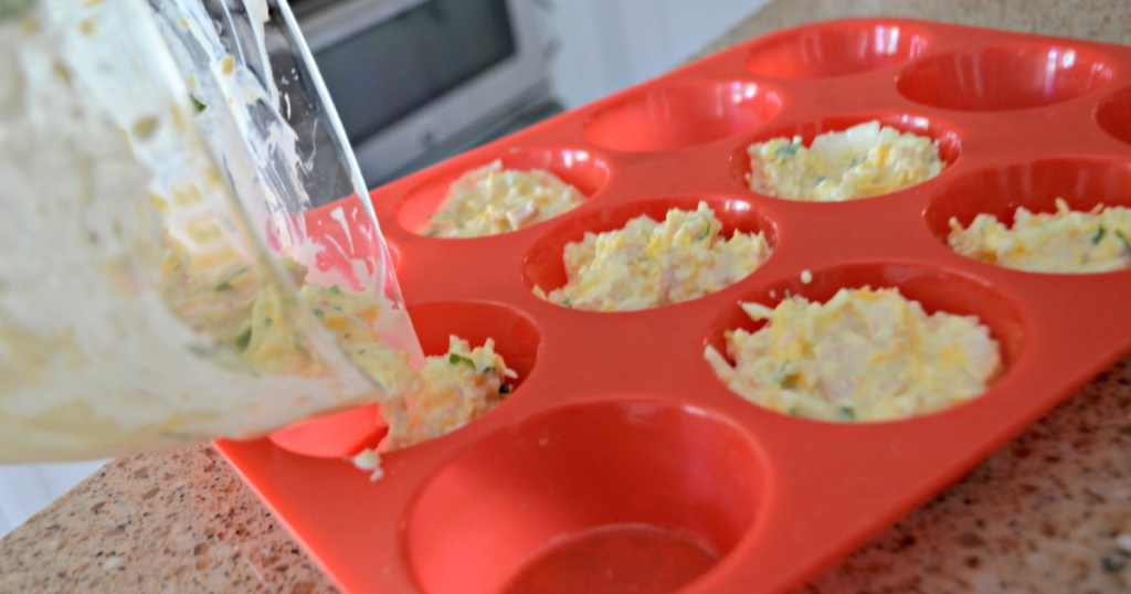 pouring tuna egg cups into muffin tin