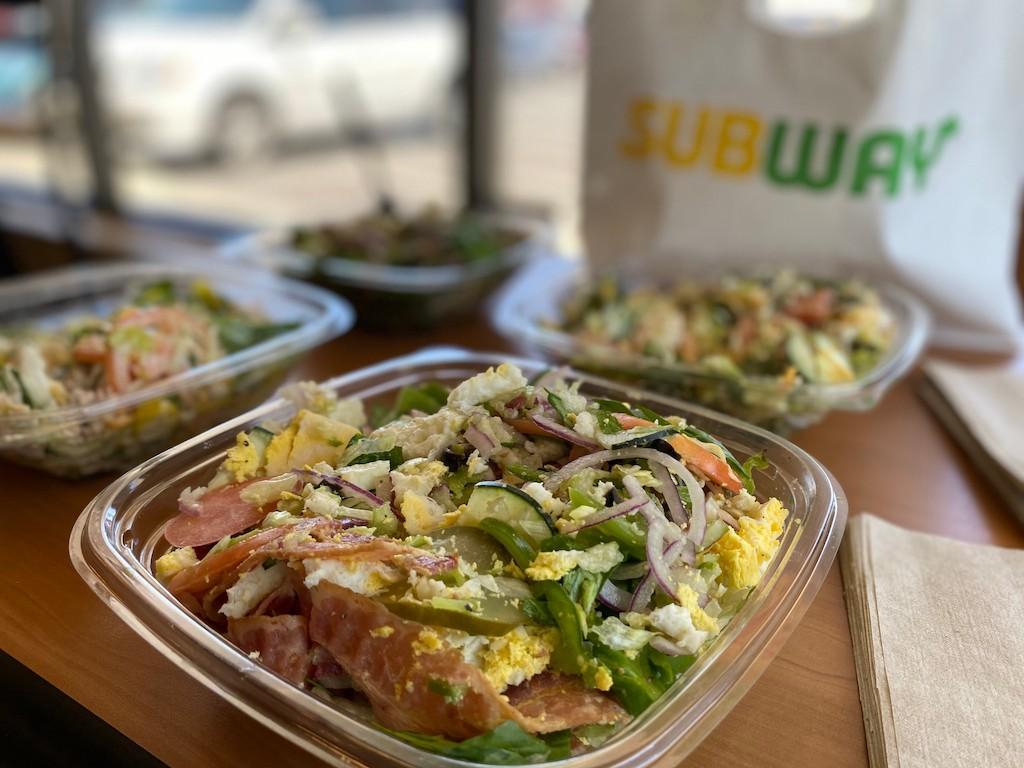 4 subway salads on table