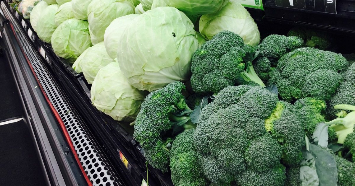 habits of successful keto eaters — cabbage and broccoli in the store produce section