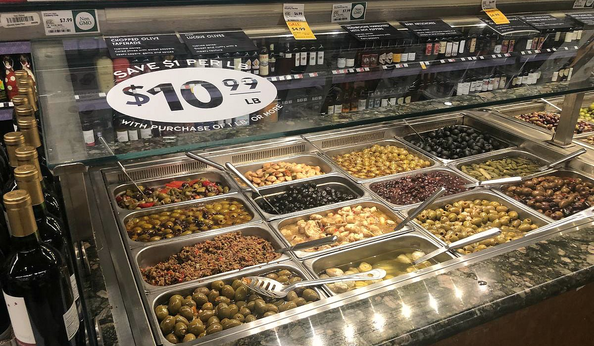 keto whole foods shopping tips to save money — olive bar assortment