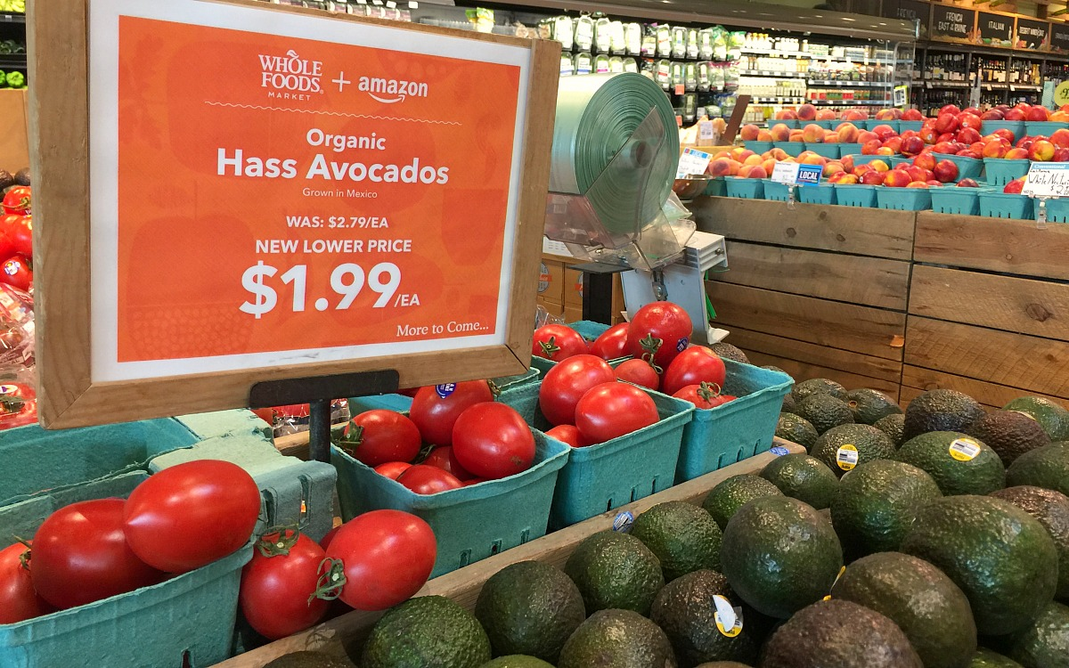 keto whole foods shopping tips to save money — display of hass avocados