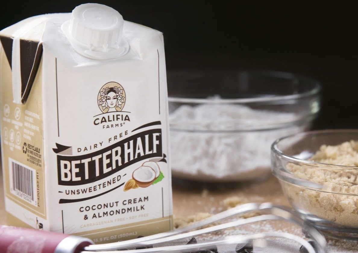 we love Califia Dairy Free coffee creamer - here, the box and a cup of coffee
