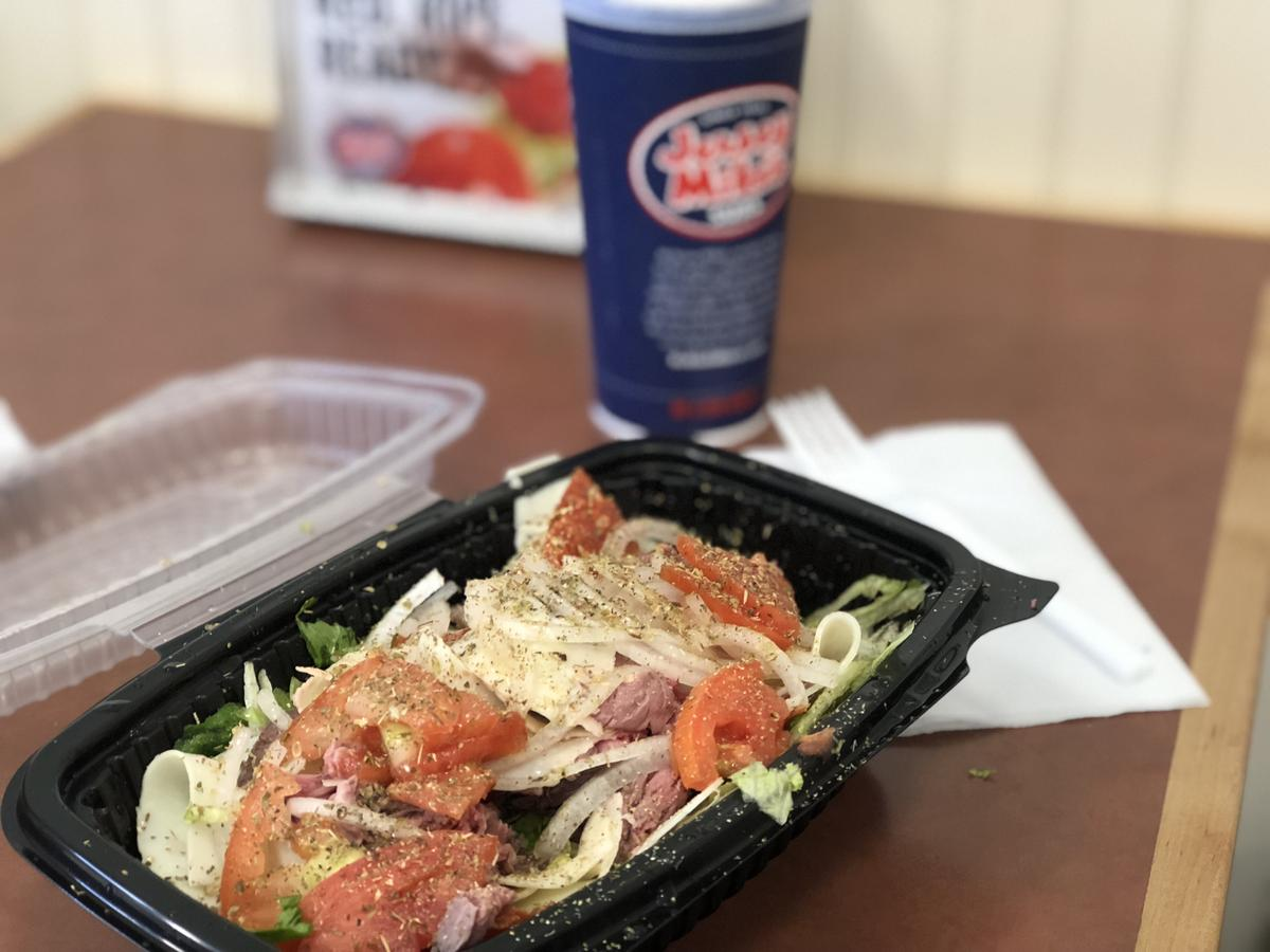 Jersey Mikes Sub in a Tub pictured next to a drink