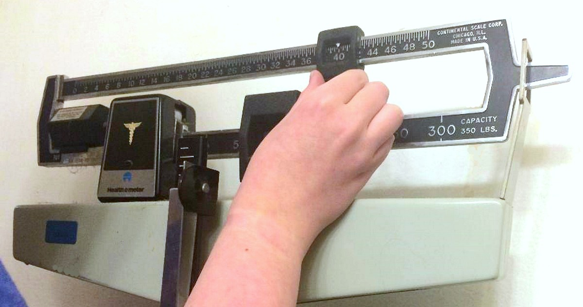 person using a doctor's scale
